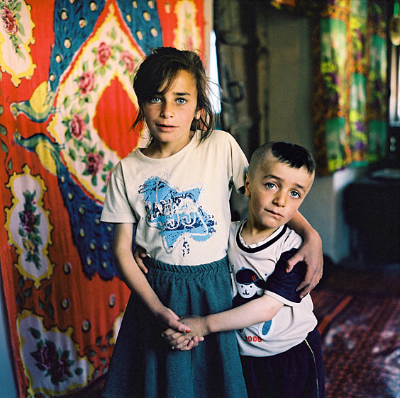 Zulfiya with her little brother at home. Xinaliq village. Azerbaijan. 2006