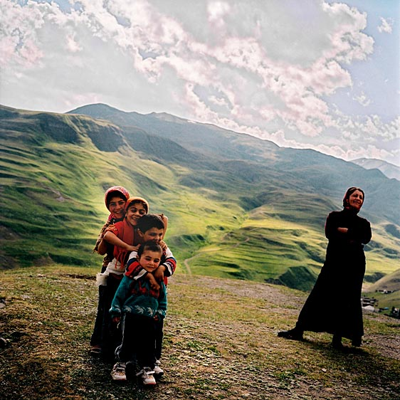 Children playing in the hills surrounding the village. At the height of over 2,300 meters, Xinaliq is located above the tree line. Azerbaijan. June, 2006
