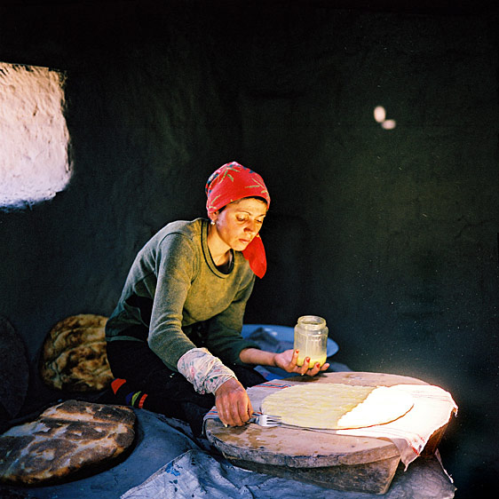 Woman baking bread in a traditional