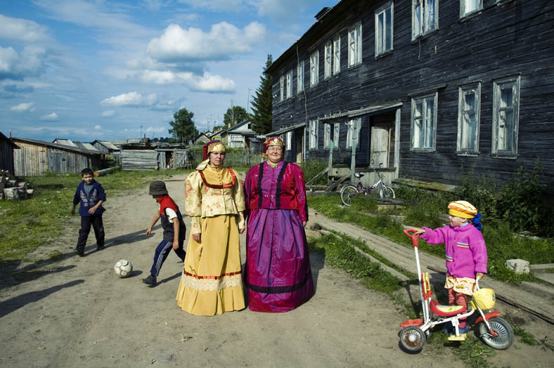 Anna and Olga are dressed in the traditional Russian clothes of Northern regions. They sing in a local folk group and dream for more tourists to come to Kenozero.