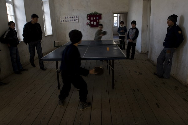 Children are playing table tennis at school. Table tennis was a gift from President Bako Sahakyan. When he came to the village for his campaign teachers asked him for chess and table tennis.