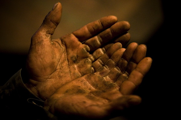 Hands of 32 years old Hamlet Pilyan. He is doing hard work in the village to earn and to raise his daughter.