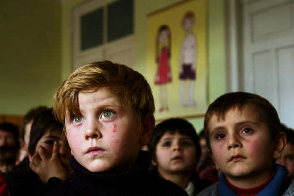 January 2008. Kindergarten. A boy with green eyes, Omaar, 7 years old. Omaar's family was bombed during the Chechen war while he was just a baby. He was left with his grandmother, who survived the bombing.