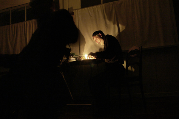 March 2008. Chechen man, Islam, in his house. Islam lost his brother during the bombing of Grozny - he still remembers his brother dying in his arms. Due to lack of electricity, night is very dark.