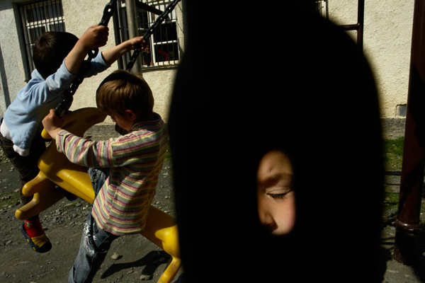Kindergarten. Chechen refugee boys on the playground.
