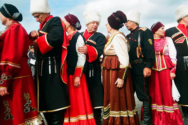 "Cossack men and women at the festival ""Legends of Taman"" in honour of the 218th anniversary of the Cossacks' arrival in Taman. In 1792 Empress Catherine II (or Catherine the Great) granted the land of Kuban to the Cossacks of Zaporizhian Sich. In 2009 in honour of the Cossacks' arrival in this region, Ataman, an ethno-tourist complex the size of the historical Cossack settlement was built. Taman. September 2010"