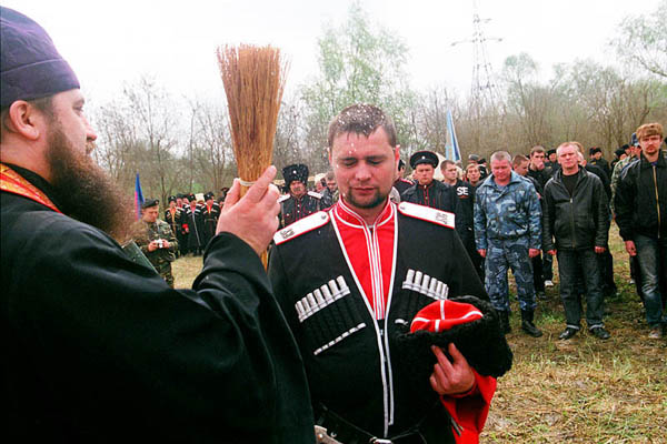 A Cossack is sprinkled with holy water during the ceremony of taking the oath. Stanitsa Elizavetinskaya. April 2010