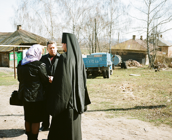 Father Nikodim, 25, the Dean of the Monastery talking with a member of Parliament of the Tula region.