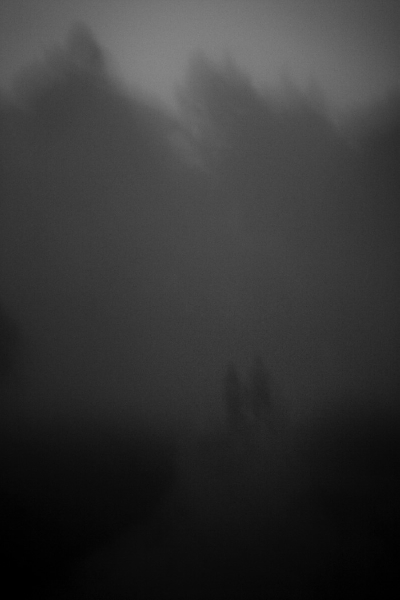 Young couple walking in the fog