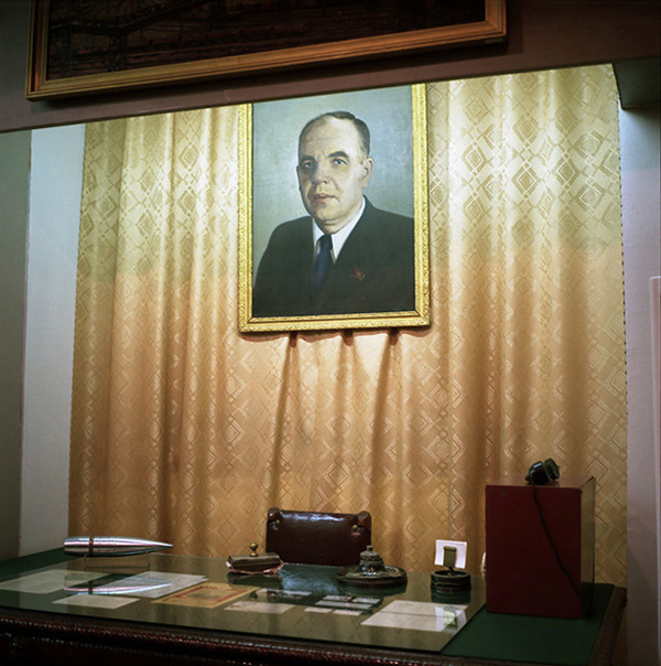 A painted portrait of the WWII-era mill manager - Grigory Nosov - and his desk preserved at the mill museum.