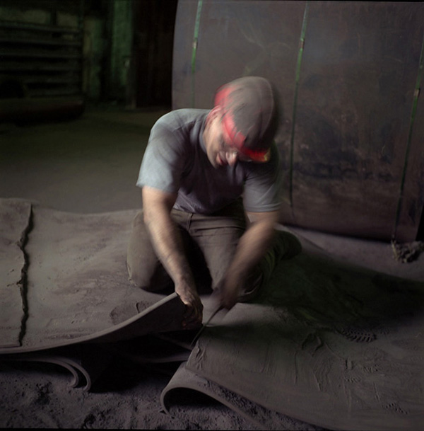 A man at work at the Magnitogorsk Steel Mill. Poor safety causes accidents which are skillfully concealed while air pollutants such as heavy metals, sulfur dioxide and lead made almost the entire population of Magnitka a hostage of the mill.