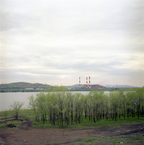 View from the European side of the Ural River to the industrial area on the Asian side.