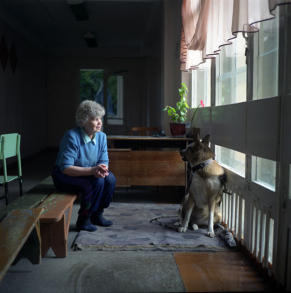 Tamara Semenovna, a night security guard at a school, with her dog.