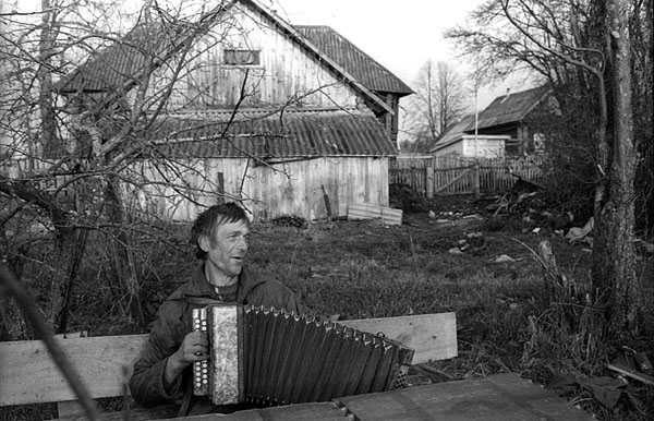 Grisha, the village accordeon player near his home in Ivtsino village, Yaroslav Region