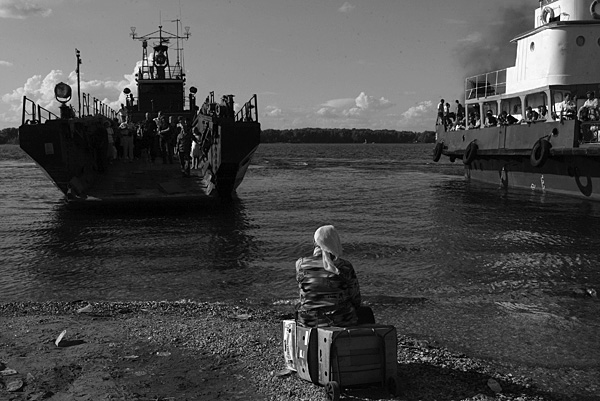 A woman waiting for the ferry from the other bank of the Volga river, Samara.